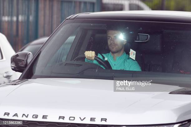 Liverpool's English midfielder Jordan Henderson arrives at Melwood in Liverpool north west England for a training session on May 19 2020
