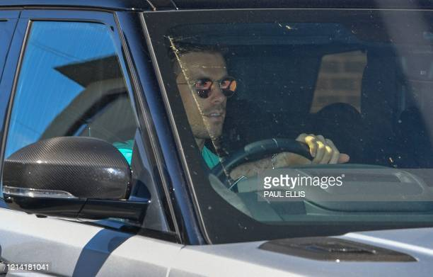 Liverpool's English midfielder Jordan Henderson arrives at Melwood in Liverpool north west England to resume training on May 20 as training resumes...