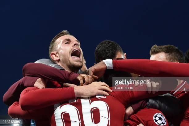 TOPSHOT Liverpool's English midfielder Jordan Henderson celebrates after Liverpool's Dutch midfielder Georginio Wijnaldum scores their third goal...