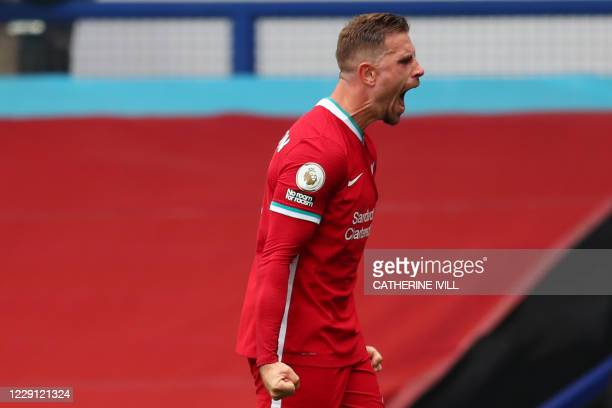 Liverpool's English midfielder Jordan Henderson celebrates celebrates scoring his team's third goal which is overturned by VAR during the English...