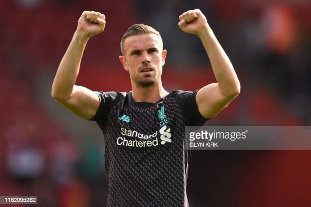 Liverpool's English midfielder Jordan Henderson celebrates on the pitch after the English Premier League football match between Southampton and...