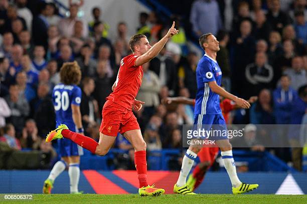 Liverpool's English midfielder Jordan Henderson celebrates scoring his team's second goal during the English Premier League football match between...