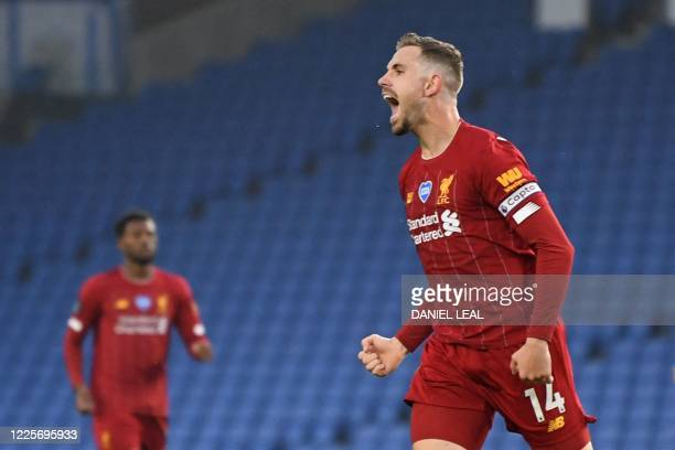 Liverpool's English midfielder Jordan Henderson celebrates scoring their second goal during the English Premier League football match between...