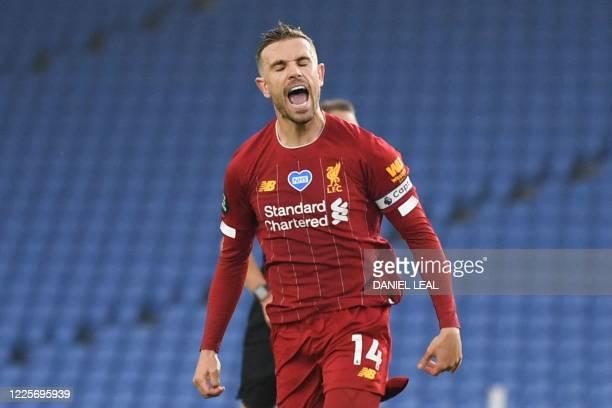 Liverpool's English midfielder Jordan Henderson celebrates scoring their second goal during the English Premier League football match between...