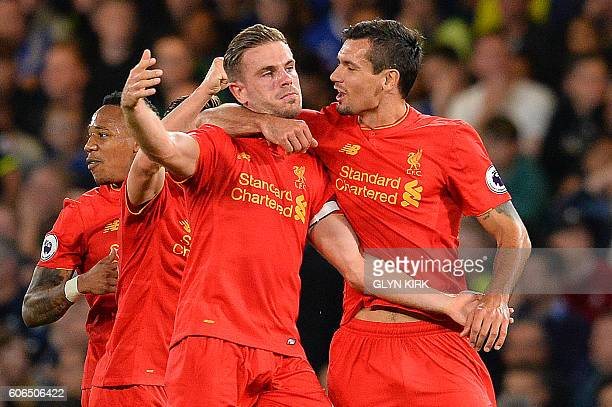 Liverpool's English midfielder Jordan Henderson celebrates with Liverpool's Croatian defender Dejan Lovren after scoring his team's second goal...