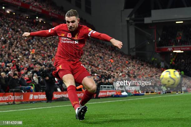 Liverpool's English midfielder Jordan Henderson crosses the ball in the build-up to their third goal during the English Premier League football match...