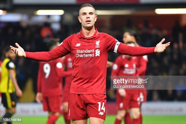 Liverpool's English midfielder Jordan Henderson gestures during the English Premier League football match between Watford and Liverpool at Vicarage...