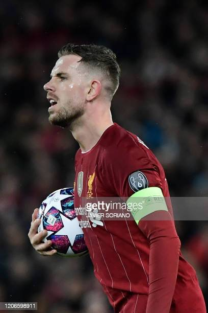 Liverpool's English midfielder Jordan Henderson gestures during the UEFA Champions league Round of 16 second leg football match between Liverpool and...