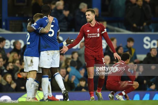 Liverpool's English midfielder Jordan Henderson greets Evertong players after drawing the English Premier League football match between Everton and...