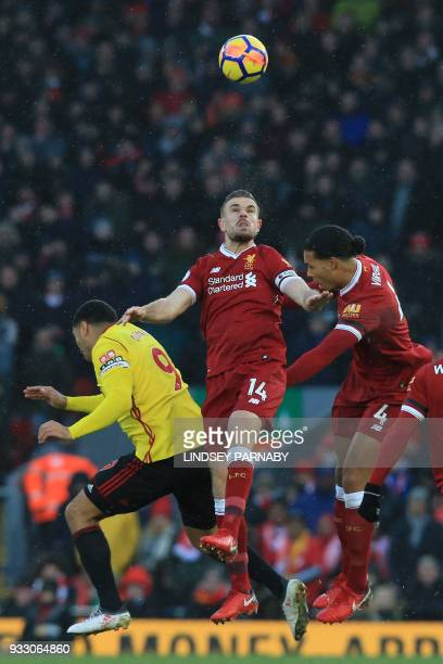 Liverpool's English midfielder Jordan Henderson heads the all during the English Premier League football match between Liverpool and Watford at...