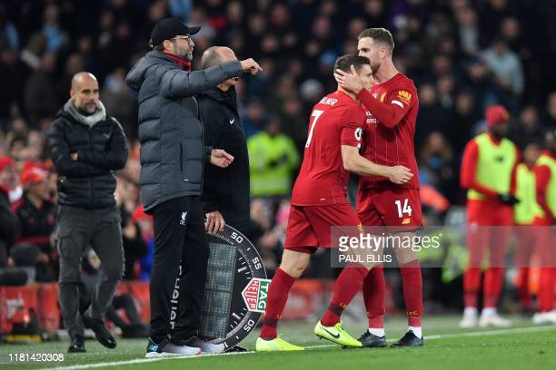Liverpool's English midfielder Jordan Henderson is substituted for Liverpool's English midfielder James Milner during the English Premier League...
