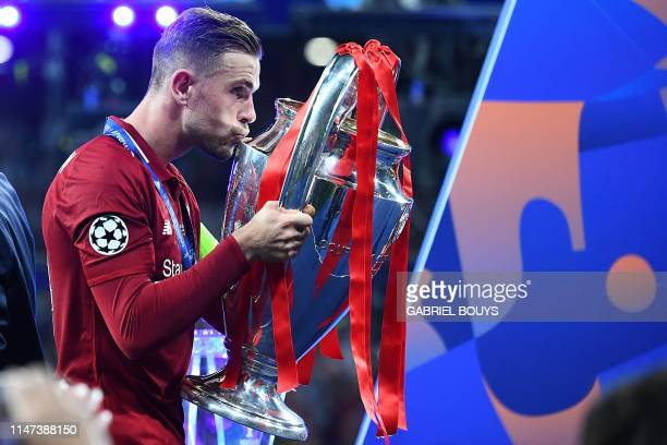 Liverpool's English midfielder Jordan Henderson kisses the European Champion Clubs' Cup after winning the UEFA Champions League final football match...