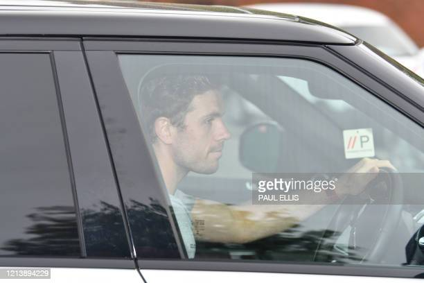 Liverpool's English midfielder Jordan Henderson leaves Melwood in Liverpool north west England after a training session on May 19 2020