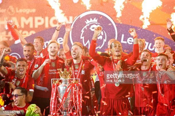 Liverpool's English midfielder Jordan Henderson , Liverpool's Dutch defender Virgil van Dijk , Liverpool's English midfielder James Milner and...