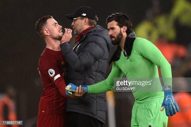 Liverpool's English midfielder Jordan Henderson Liverpool's German manager Jurgen Klopp and Liverpool's Brazilian goalkeeper Alisson Becker react at...