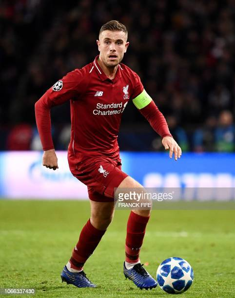 Liverpool's English midfielder Jordan Henderson plays the ball during the UEFA Champions League Group C football match between Paris SaintGermain and...