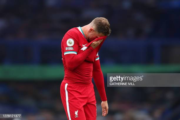 Liverpool's English midfielder Jordan Henderson reacts at the final whistle during the English Premier League football match between Everton and...