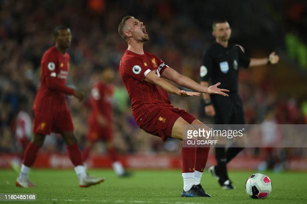 Liverpool's English midfielder Jordan Henderson reacts during the English Premier League football match between Liverpool and Norwich City at Anfield...