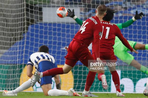 Liverpool's English midfielder Jordan Henderson scores his team's second goal during the English Premier League football match between Brighton and...