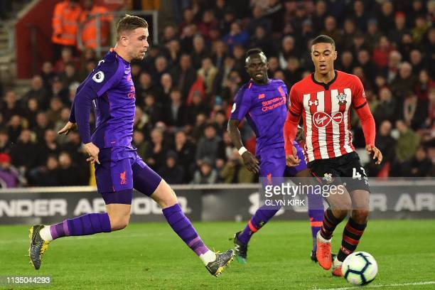 Liverpool's English midfielder Jordan Henderson scores their third goal during the English Premier League football match between Southampton and...