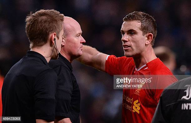 Liverpool's English midfielder Jordan Henderson speaks to the referee Lee Mason at the final whistle during the English Premier League football match...
