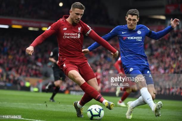 Liverpool's English midfielder Jordan Henderson vies with Chelsea's Danish defender Andreas Christensen during the English Premier League football...