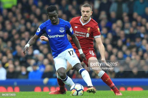 Liverpool's English midfielder Jordan Henderson vies with Everton's Senegalese midfielder Idrissa Gueye during the English Premier League football...
