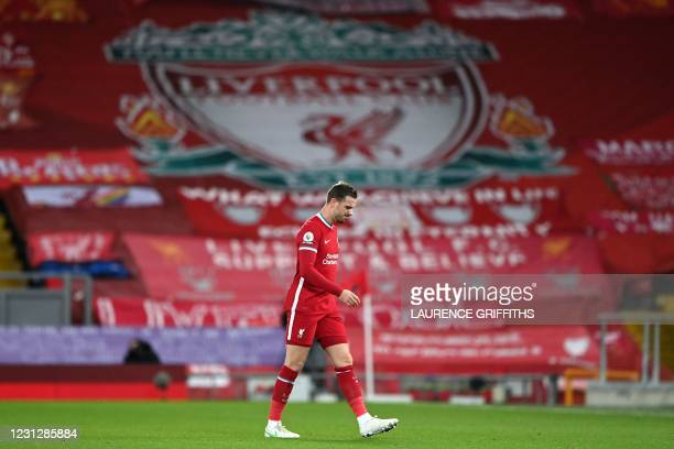 Liverpool's English midfielder Jordan Henderson walks off the pitch injured during the English Premier League football match between Liverpool and...