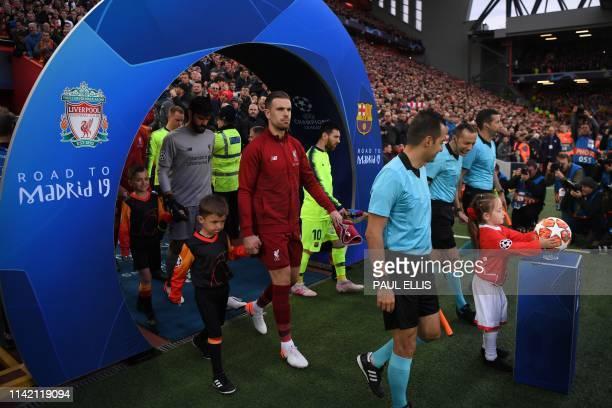 Liverpool's English midfielder Jordan Henderson walks onto the pitch before the UEFA Champions league semi-final second leg football match between...
