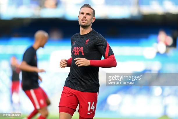 Liverpool's English midfielder Jordan Henderson warm up ahead of the English Premier League football match between Chelsea and Liverpool at Stamford...