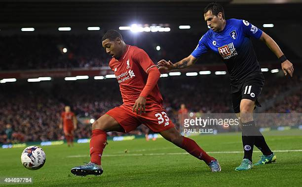 Liverpool's English midfielder Jordon Ibe vies against Bournemouth's English midfielder Charlie Daniels during the English League Cup fourth round...
