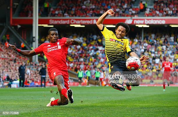 Liverpool's English midfielder Oluwaseyi Ojo vies with Watford's Scottish midfielder Ikechi Anyaafter during the English Premier League football...