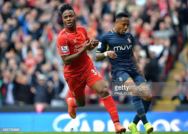 Liverpool's English midfielder Raheem Sterling celebrates scoring the opening goal during the English Premier League football match between Liverpool...