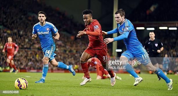 Liverpool's English midfielder Raheem Sterling is chased by Sunderland's English midfielder Adam Johnson and Sunderland's Spanish midfielder Jordi...
