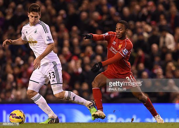 Liverpool's English midfielder Raheem Sterling vies with Swansea City's Argentinian defender Federico Fernandez during the English Premier League...