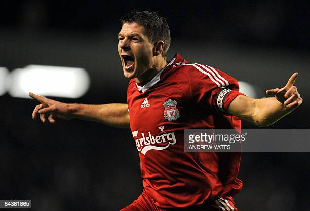 Liverpool's English midfielder Steven Gerrard celebrates after scoring the opening goal during the Premier league football match against Everton at...