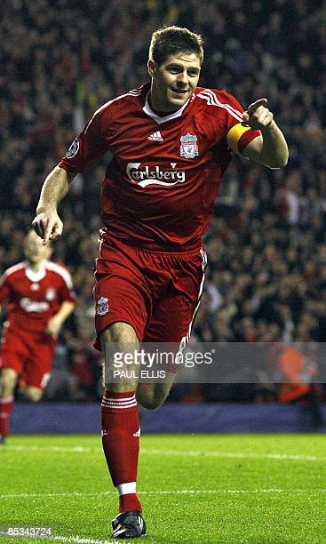 Liverpool's English midfielder Steven Gerrard celebrates after scoring the third goal during their UEFA Champions League second round second leg...