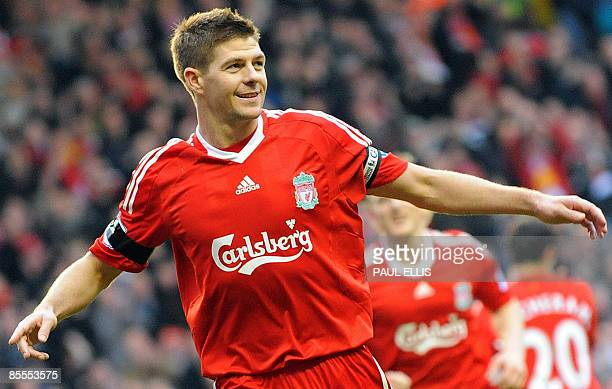 Liverpool's English midfielder Steven Gerrard celebrates his third goal during their English Premier League football match against Aston Villa at...
