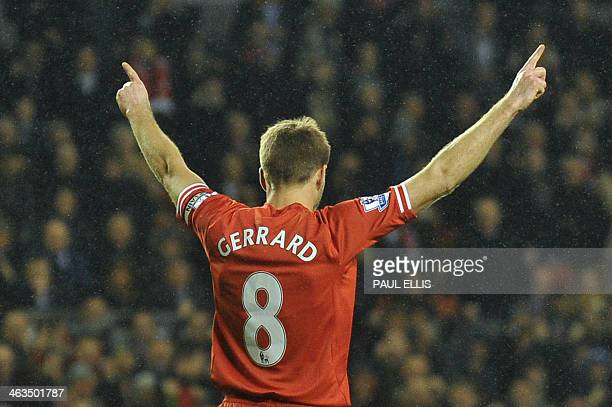 Liverpool's English midfielder Steven Gerrard celebrates scoring from the penalty spot to level the score during the English Premier League football...