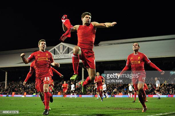 Liverpool's English midfielder Steven Gerrard celebrates scoring their third goal during the English Premier League football match between Fulham and...