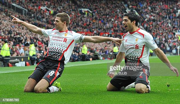 Liverpool's English midfielder Steven Gerrard celebrates with Liverpool's Uruguayan forward Luis Suarez after scoring his team's second goal during...