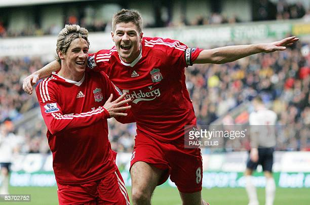 Liverpool's English midfielder Steven Gerrard celebrates with Spanish forward Fernando Torres after scoring against Bolton Wanderers during their...