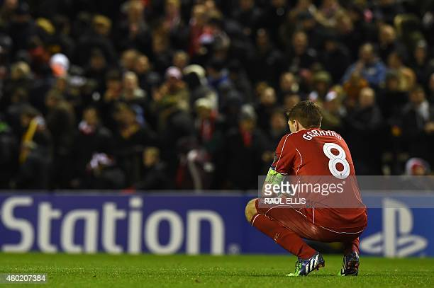 Liverpool's English midfielder Steven Gerrard crouches on the pitch after the final whistle of the UEFA Champions League group B football match...