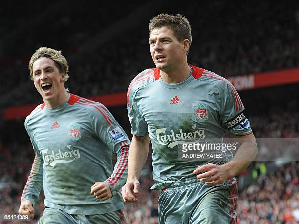Liverpool's English midfielder Steven Gerrard is congratulated by Spanish forward Fernando Torres after scoring a penalty against Manchester United...