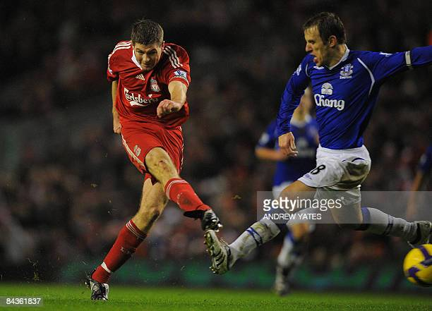 Liverpool's English midfielder Steven Gerrard scores the opening goal during the Premier league football match against Everton at Anfield Liverpool...