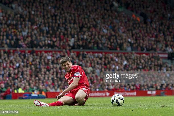 Liverpool's English midfielder Steven Gerrard slides for the ball during the English Premier League football match between Liverpool and Crystal...