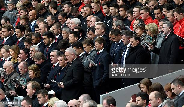 Liverpool's English midfielder Steven Gerrard stands with his teammates during a memorial service at Anfield in Liverpool north west Engand on April...