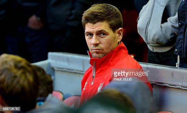 Liverpool's English midfielder Steven Gerrard takes his seat on the bench ahead of the English Premier League football match between Liverpool and...