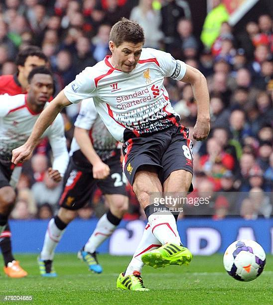 Liverpool's English midfielder Steven Gerrard takes the second penalty during the English Premier League football match between Manchester United and...