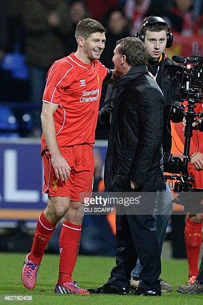 Liverpool's English midfielder Steven Gerrard talks with Liverpool's Northern Irish manager Brendan Rodgers after the final whistle during the FA Cup...